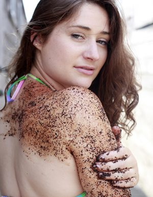 emily with scrub on arms and shoulder